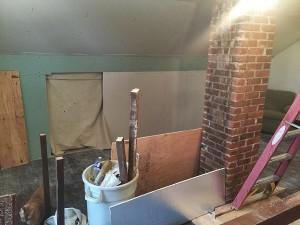 Exposed brick chimney.